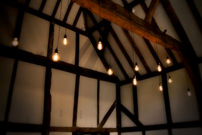 Bare Bulbs Hanging From Barn Beam