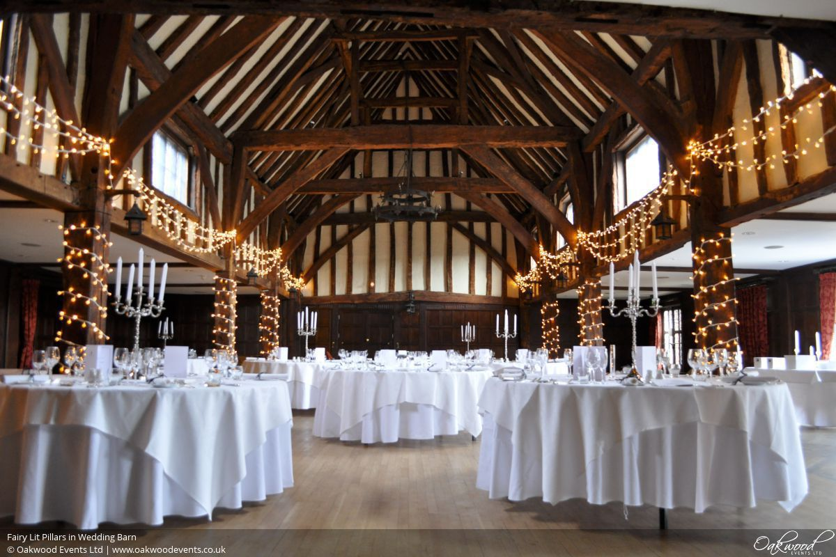 Fairy light hire wedding and event lighting by oakwood events lights with fabric drops fairy lit pillars in wedding barn aloadofball Image collections